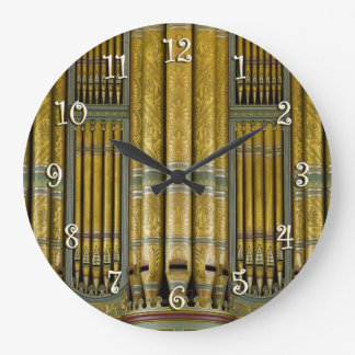Green and gold  organ pipes round clock