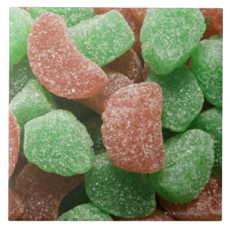 Green and red sugared candies ceramic tile