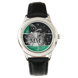 Green  and silver monogram on black watches