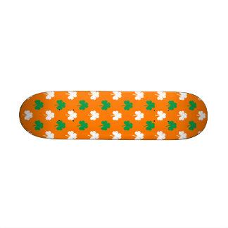 Green And White Heart-Shaped Shamrock On Orange Skate Decks