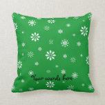 Green and white snowflakes throw pillows