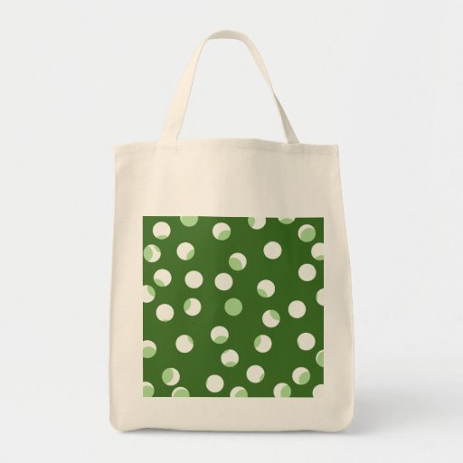 Green and white spotty pattern. tote bag