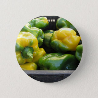 Green and yellow peppers in box button