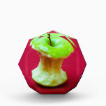 """Green apple core acrylic award<br><div class=""""desc"""">Photo of a big green apple against red background. The apple is eaten out,  only the core is left.</div>"""