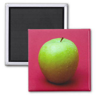 Green apple on red background 2 inch square magnet