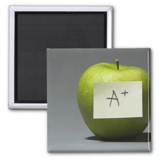 Green apple with adhesive note with letter A and 2 Inch Square Magnet