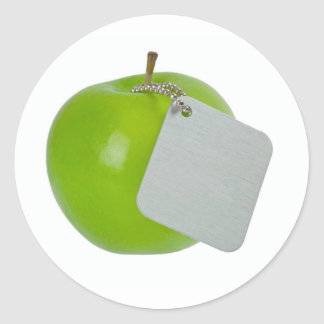 Green apple with metal tag