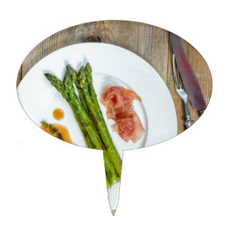 Green asparagus with ham and sauce cake topper