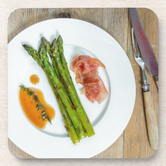 Green asparagus with ham and sauce coaster
