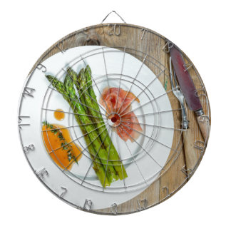 Green asparagus with ham and sauce dartboard