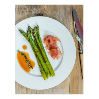 Green asparagus with ham and sauce postcard
