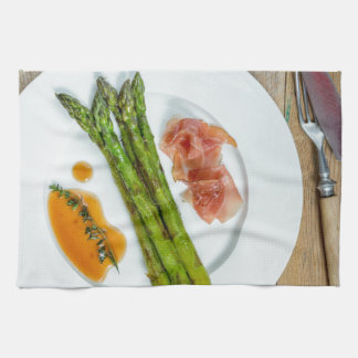 Green asparagus with ham and sauce towels