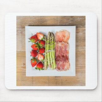 Green asparagus with ham and strawberries mouse pad