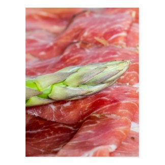 Green asparagus with ham macro postcard