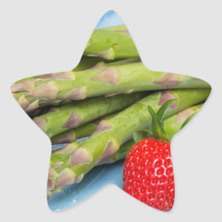 Green asparagus with strawberries on wooden star sticker