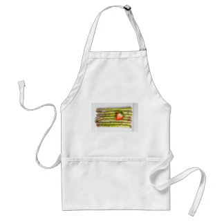 Green asparagus with strawberries top view adult apron