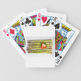 Green asparagus with strawberries top view bicycle playing cards