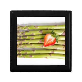 Green asparagus with strawberries top view keepsake box