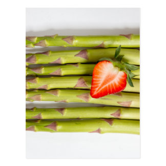 Green asparagus with strawberries top view postcard