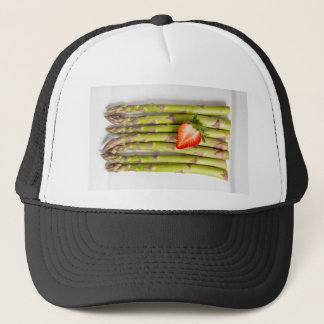 Green asparagus with strawberries top view trucker hat