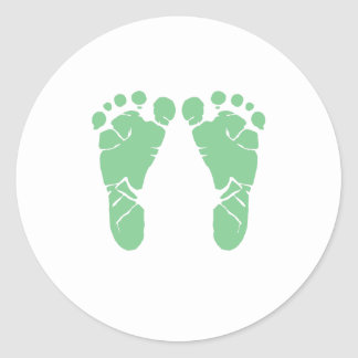 Green baby footprints classic round sticker