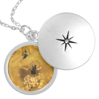 green beetle and yellow flower round locket necklace