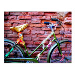 Green Bicycle Leaning Against a Brick Wall Postcards