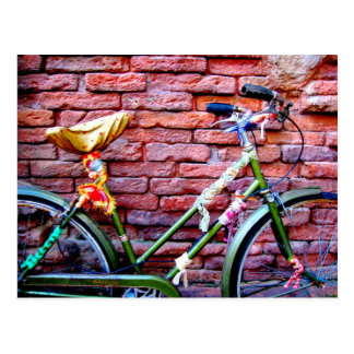 Green Bicycle Leaning Against a Brick Wall Postcard