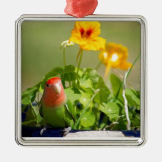 Green bird in has spring garden metal ornament