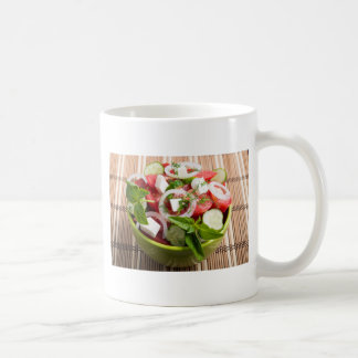 Green bowl with tasty and wholesome vegetarian coffee mug