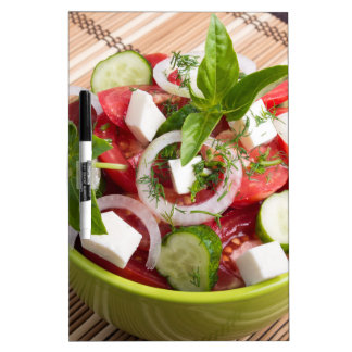 Green bowl with tasty and wholesome vegetarian Dry-Erase board
