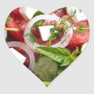 Green bowl with tasty and wholesome vegetarian heart sticker