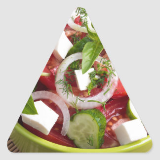 Green bowl with tasty and wholesome vegetarian triangle sticker