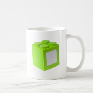 Green building block with copyspace coffee mug