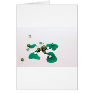 Green candied cherries syrup on icing sugar card