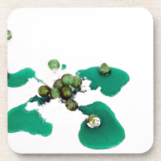 Green candied cherries syrup on icing sugar coasters