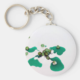 Green candied cherries syrup on icing sugar keychain