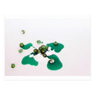 Green candied cherries syrup on icing sugar postcard
