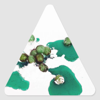 Green candied cherries syrup on icing sugar triangle sticker