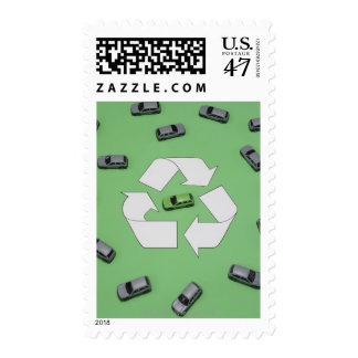 Green car surrounded by grey cars postage