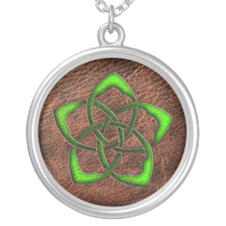 Green celtic flower knot on leather jewelry