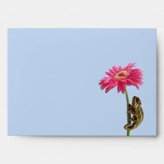 Green chameleon on pink flower envelope
