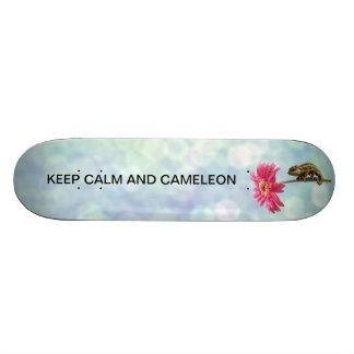 Green chameleon on pink flower skateboard