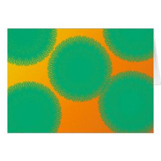 green circle in yellowish orange card