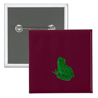 green colorized frong against burgundy buttons