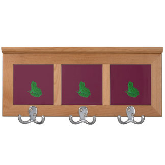 green colorized frong against burgundy coat rack