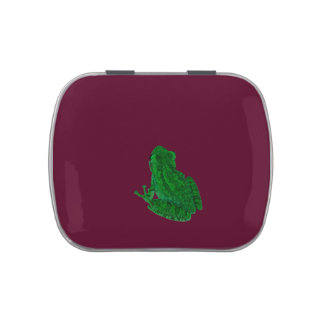 green colorized frong against burgundy jelly belly candy tin