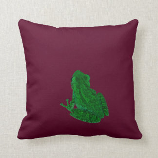 green colorized frong against burgundy throw pillow