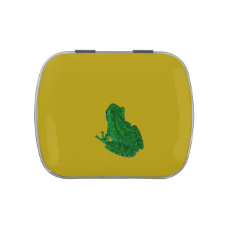 Green colorzed frog against yellow look up candy tin