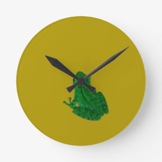 Green colorzed frog against yellow look up round wall clocks